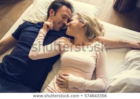 Férj feleség ágy együtt pár üveg Stock fotó © photography33