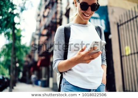 meisje · smartphone · lopen · stad · jonge · vrouw · straat - stockfoto © adamr