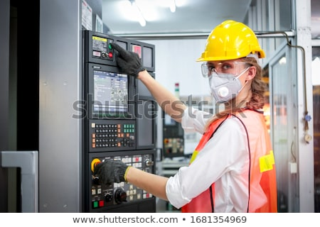female laborer touching an electrical wire stock photo © photography33