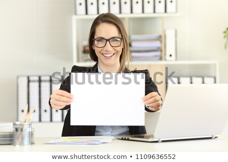 Female executive showing an advertising board Stock photo © stockyimages