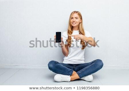 Szőke nő mutat mutatóujj csinos izolált fehér Stock fotó © acidgrey