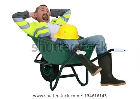 Man taking a snooze in a wheelbarrow Stock photo © photography33