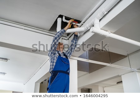 Plumber with piping Stock photo © photography33