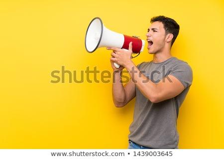 knappe · man · megafoon · heldere · foto · man · gelukkig - stockfoto © dolgachov