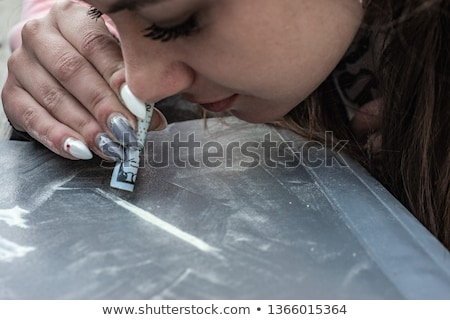 Person snorting a line of illegal white substance Stock photo © wavebreak_media
