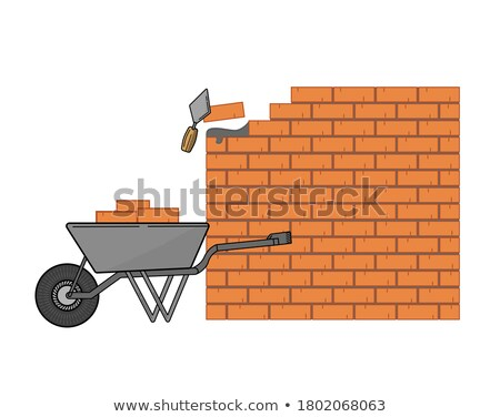 mason carrying bricks in wheel barrow stock photo © photography33