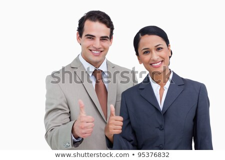 Smiling tradeswoman giving two thumb's up Stock photo © photography33