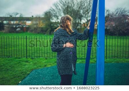 Grávida mulheres em pé sozinho jogar belo Foto stock © privilege