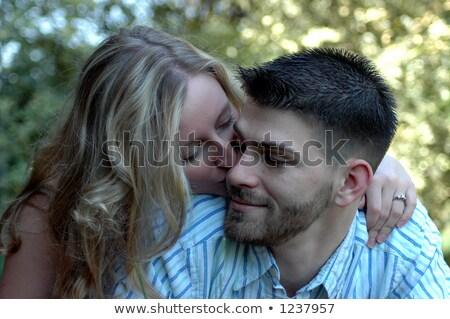 Homme femme engagé baiser Photo stock © cboswell
