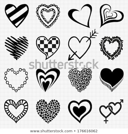 Icon of Heart in the Hand on Handmade Paper Decoration. Stock photo © tashatuvango