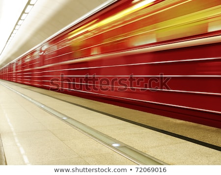 Fast moving train with red stripe Stock photo © juniart