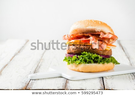 Grilled hamburger with bacon on a white plate Stock photo © phila54