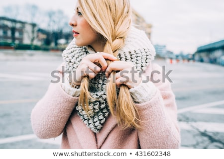 Attractive blond woman with her hair in a braid Stock photo © dash