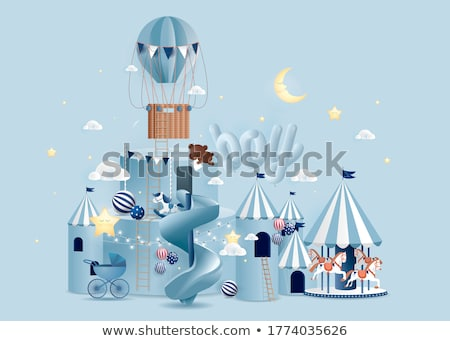 Carousels on a blue background Stock photo © castenoid