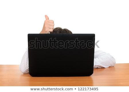 man hiding behind laptop isolated on a white background stock photo © deandrobot