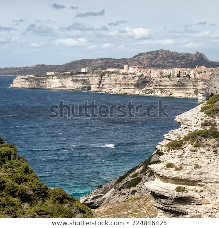 Citadel and houses of Bonifacio above towering white cliffs Stock photo © Joningall