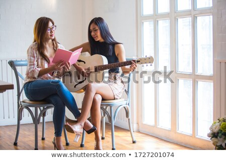 two beautiful girls playing guitars stock photo © master1305