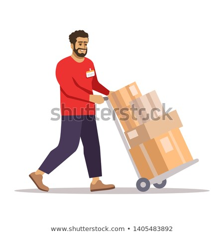 Worker pulling trolley with boxes in warehouse Stock photo © wavebreak_media