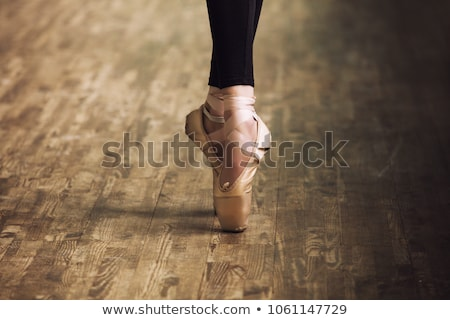 The close-up feet of young ballerina in  old pointe shoes  Stock photo © master1305
