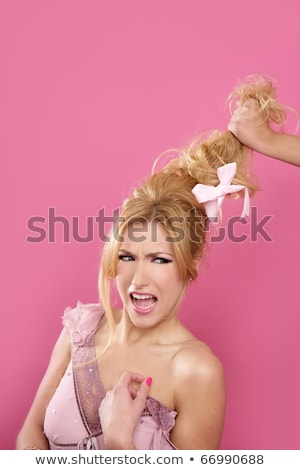 domestic gender violence metaphor hand holding hair stock photo © lunamarina