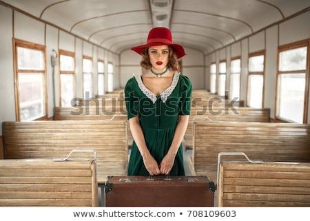 Woman and vintage suitcase on railway road Stock photo © deyangeorgiev