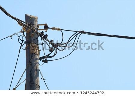 power poles with many wires stock photo © klinker