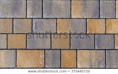 Paving blocks made of square stone in bright ligh Stock photo © meinzahn