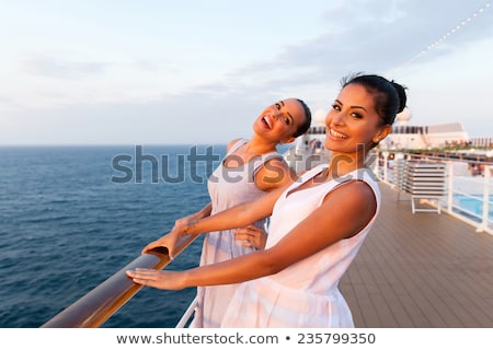 Stock fotó: Kettő · gyönyörű · lányok · csónak · fiatal · nők · naplemente