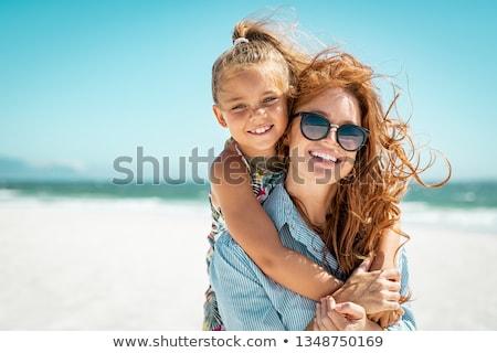Háton kicsi lánygyermek anya fű szülők Stock fotó © Giulio_Fornasar
