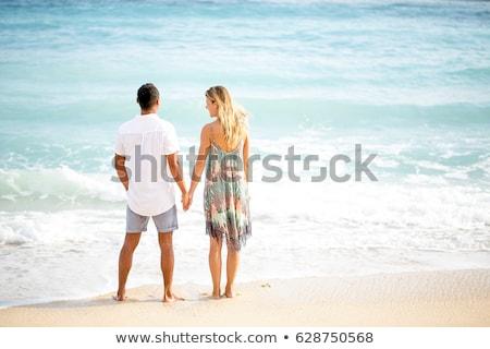 Stockfoto: Romantische · echtpaar · permanente · strand · zonsondergang · man