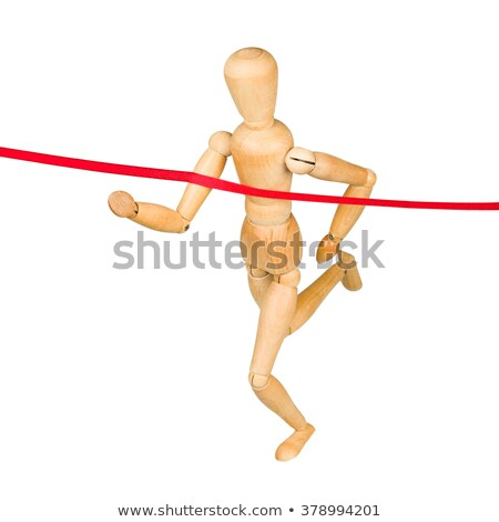 Wooden mannequin running through finishing line Stock photo © pakete