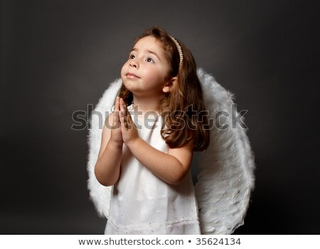 little angel child serenely looking to heaven stock photo © lovleah