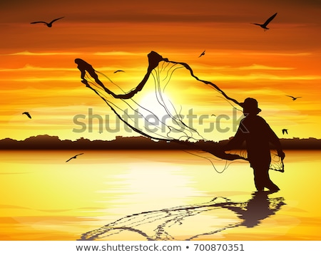 silhouette of fishermen with and orange sun  Stock photo © mady70