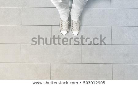 Man standing on concrete flooring surface, feet from above Stock photo © stevanovicigor