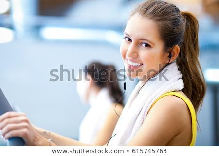 jonge · vrouw · gymnasium · machine · sport · fitness - stockfoto © rob_stark