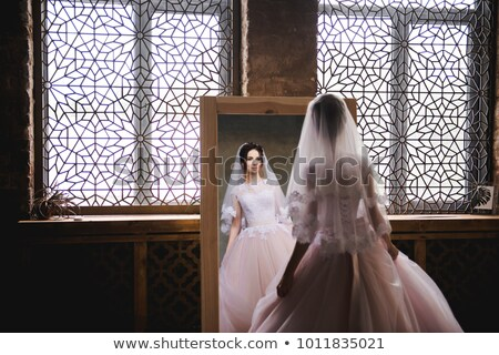 spin the bride in a wedding dress in a white room stock photo © dmitriisimakov