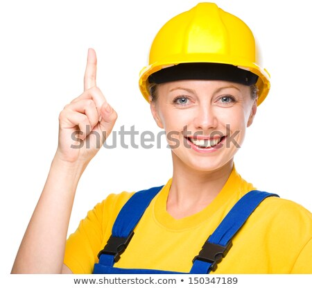 Young caucasian builder pointing forefinger up. Stock photo © RAStudio