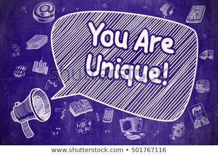 You Are Unique - Doodle Illustration on Blue Chalkboard. Stock photo © tashatuvango