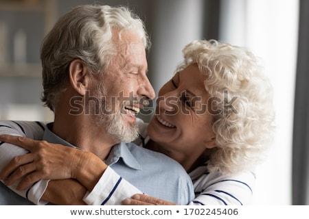 Közelkép idősebb pár átkarol nő természet Stock fotó © IS2