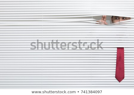 Man looking through blinds Stock photo © IS2