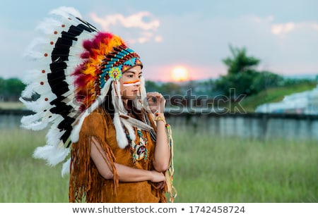 Girl dressed in Native American costume with face painted Stock photo © IS2