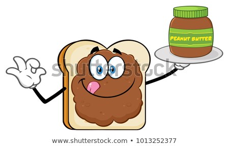 Bread Slice Cartoon Mascot Character With Peanut Butter Holding A Jar Of Peanut Butter Stock photo © hittoon