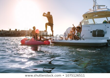 Young woman diving into sea from yacht Stock photo © IS2