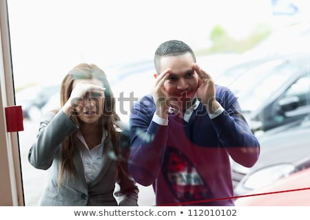 Woman looking through window, smiling Stock photo © IS2