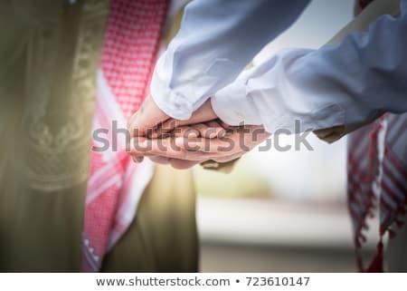 Iş adamları eller birlikte bütünleşme takım çalışması Stok fotoğraf © alphaspirit