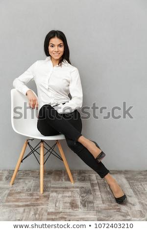 genç · gülen · işkadını · oturma · ofis · koltuğu · gri - stok fotoğraf © deandrobot