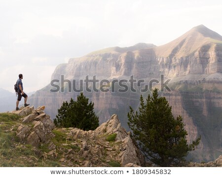 Relaxing with spectacular views of cliffs and mountains Stock photo © lovleah