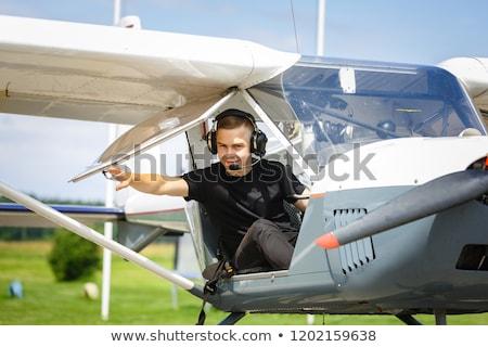 homem · piloto · sessão · cabine · pequeno · avião - foto stock © svetography
