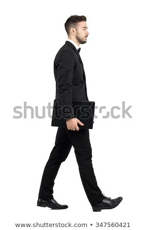 side view of a walking young elegant man in tuxedo  Stock photo © feedough