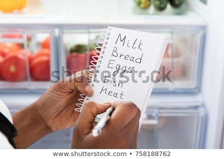 Pessoas escrita diário geladeira moço compras Foto stock © AndreyPopov